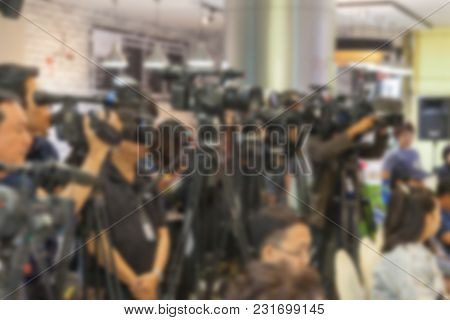 Blurry Of Group Of Man And Video Camera