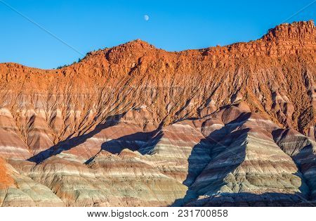 A Moon Rising Over The Scenic Landscape In The Escalante Grand Staircase National Monument Utah