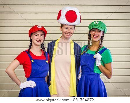 Sheffield Comic Con, Sheffield, Uk, October 7, 2017. Three Cosplayers Dressed As Super Mario,  Luigi