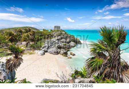 Maya Ruins With Palm Trees On The Tropical Beach Of Tulum, Mexico