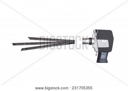 Old Movie Camera And 8mm Film On White Background