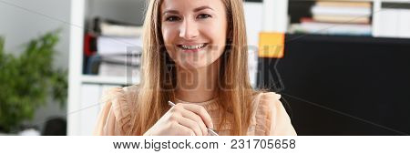 Beautiful Smiling Businesswoman Portrait At Workplace Look In Camera. White Collar Worker At Workspa