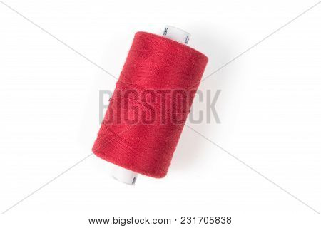 Red Sewing Thread On A White Background