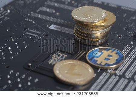 Golden Litecoin, Bitcoin, Ethereum On Motherboard Digital Cryptocurrency. Mining Concept