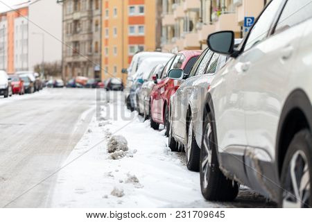 Snowbound German Cars Parked At The Roadside