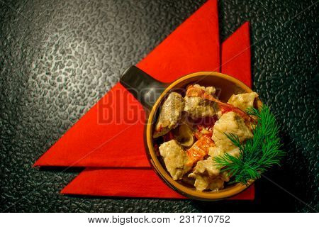 Pork In An Interesting Dish, With A Pattern Baked With Red Vegetables And Decorated With Green Dill