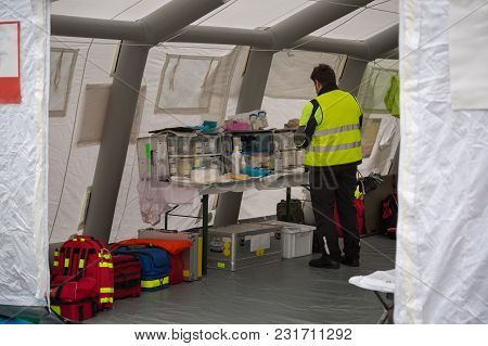 Medical Doctor Check For Medical Supplies Inside Temporary Rescue Control Centre Tent.