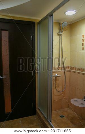 Veneered Wooden Doors In The Bathroom