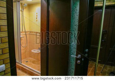 Veneered Wooden Door In The Hallway