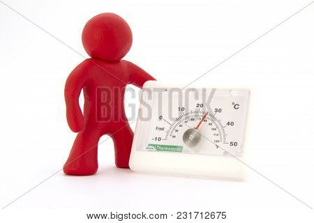 Red Plasticine Characters And Thermometer. Isolated On White Background