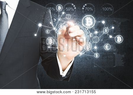 Businessman Drawing Creative Bitcoin Hologram. Cryptography And Finance Concept
