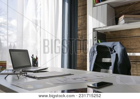 Empty Workplace With Office Desk And Chair, Jacket On The Chair, Manager On The Break