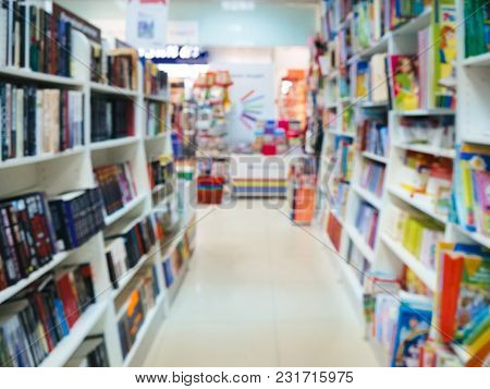 Abstract Blurred Bookshelves With Books, Manuals And Textbooks On Bookshelves In Book Store, For Bac