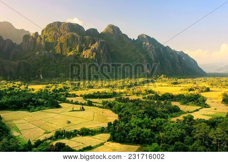 Aerial View Of Farm Fields And Rock Formations In Vang Vieng, Laos. Vang Vieng Is A Popular Destinat