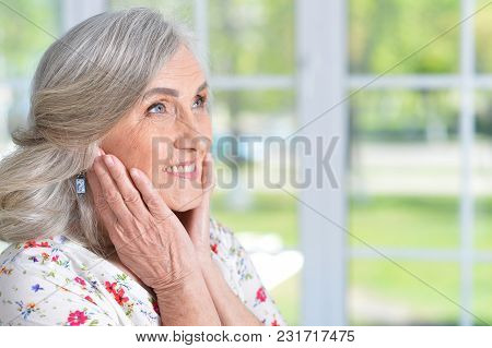 Portrait Of Happy Senior Woman Posing At Home