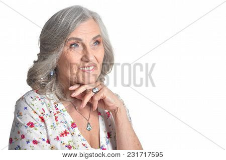Portrait Of Happy Senior Woman Posing Isolated On White Background