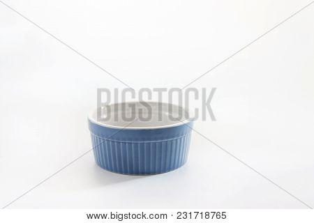 Porcelain Souffle Ramekin Dish Isolated On White Background.