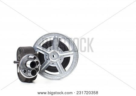 Old 8 Mm Camera And Film Reel On White Background