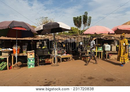 Bissau, Republic Of Guinea-bissau - January 28, 2018: Street Scene In The City Of Bissau With A Woma