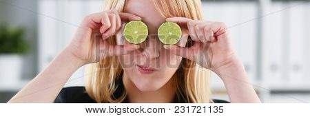 Female Hands Hold A Cut Fruit At Eye Level Instead Of Glasses. The Theme Of A Healthy Diet For Withd