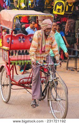 Agra, India - November 10: Unidentified Man Drives Pedicab At Kinari Bazaar On November 10, 2014 In