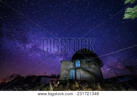 Night View Of Astronomical Observatory Against Background Of Starry Sky With Milky Way.