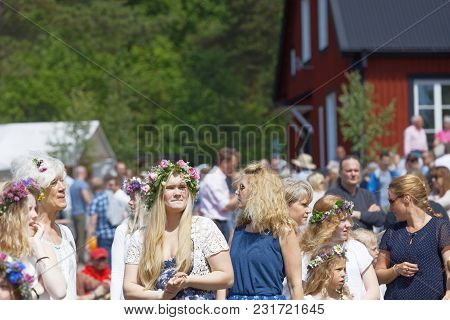 Vaddo, Sweden - June 23, 2017: Blonde Women With Flowers In Their Hair Preparing To Celebrate The Sw