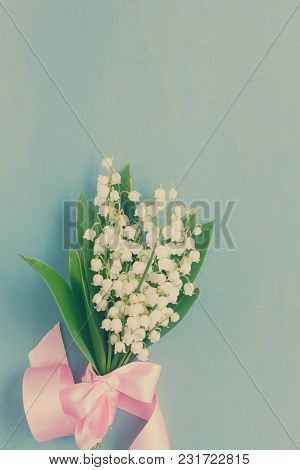 Lilly Of The Valley Flowers With Pink Ribbon On Blue Wooden Background, Retro Toned