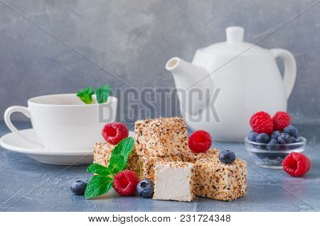 Homemade Sweets Or Candies Pigeon's Milk With A Cup Of Tea, Blueberries And Mint