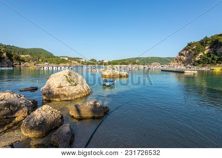 Alipa Beach In Paleokastritsa Bay With Sand And Crystal Sea Water. Corfu Island, Greece.