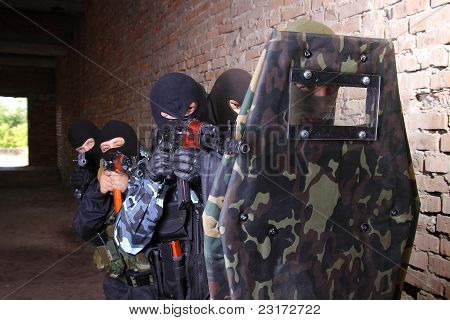 Group Of Soldier Moving Behind Tactical Shield