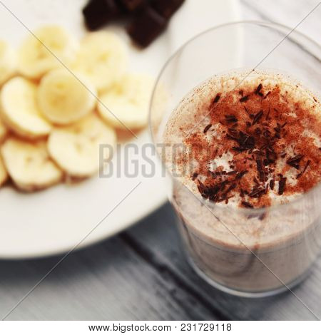 Banana Chocolate Smoothie With A Dash Of Cinnamon. A Glass Of Milk Smoothie Sprinkled With Chocolate