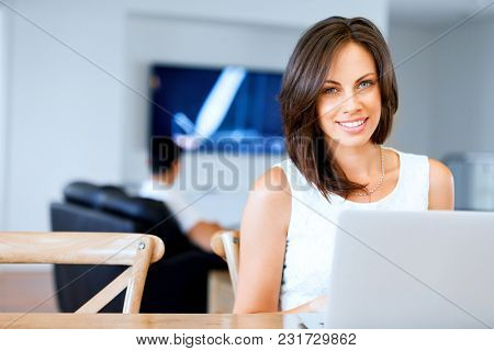 Young beautiful woman working on her laptop