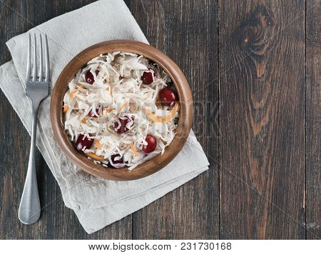 Traditional Russian Appetizer Sauerkraut With Cranberry And Carrot In Wooden Bowl On Brown Rustic Wo