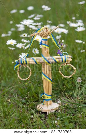 Maypole Decoration In The Grass Amoung The Daisy Flowers