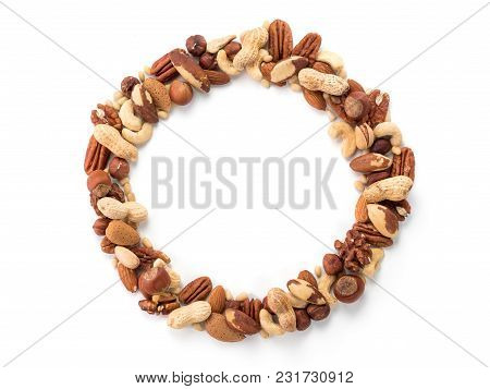 Pattern Of Nuts In Circle Form. Various Nuts Isolated On White. Pecan, Macadamia, Brazil Nut, Walnut