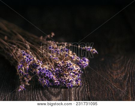 Bunch Of Lavender Flowers On Brown Wooden Table With Copy Space. Low Key