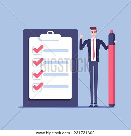 A Young Businessman Stands Next To A Giant Checklist With A Large Marker In His Hand. Office Male Em