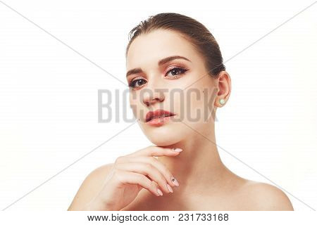 Beautiful Young Female With Make Up, Poses Nuse Against White Background, Has Mysterious Expression,