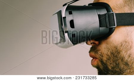 Adult Short Bearded Guy Exploring Virtual Reality Wearing Vr Goggles Being Into Technology. Studio S