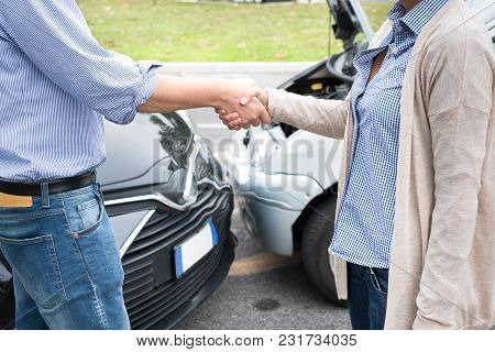 Woman And Man Agreement After Car Crash Accident