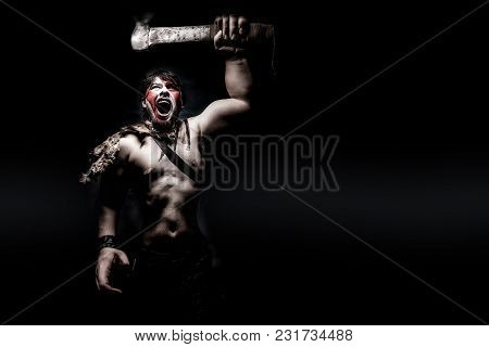 Painted Image Of Man In War Paint, With An Ax In His Hand, A Warrior Brandishing An Ax Furiously Scr