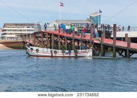 Helgoland, Germany - May 21, 2017: Little Ferry With Passengers In Harbor Of Helgoland On Its Way Fr