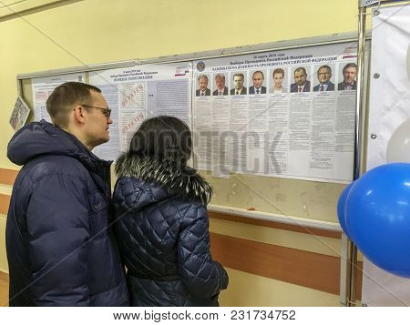 Moscow, Russia - March 18, 2018: Voters Examine The List  In The Elections Of President