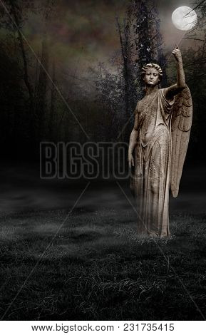 A Gothic Background Of A Spooky Wood Setting With An Angel Statue.