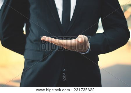 Close Up.businessman With Empty Hand On Blurred Background.
