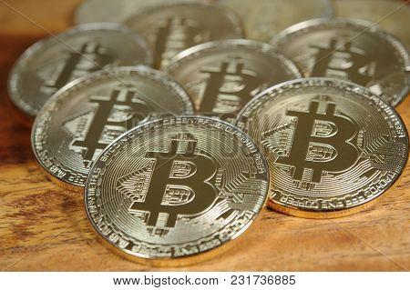 Luxury Golden Bitcoins Lying On Wooden Desk