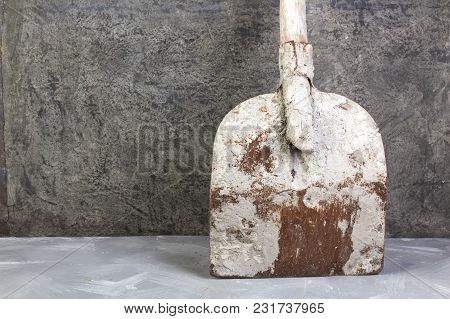 Bricks, Hammer On The Gray Concrete Background. Copy Space. Top View