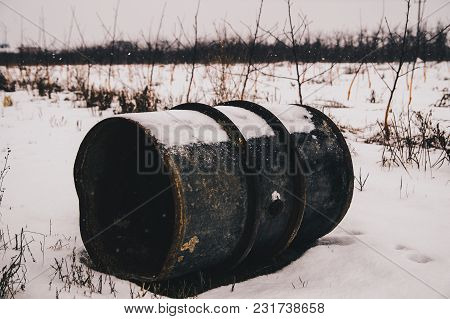 Old Metal Barrel On The Snow In Orchard