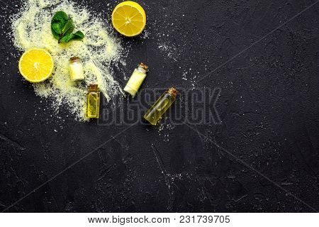 Natural Cosmetics Set With Fresh Lemon And Organic Oil On Black Table Background Top View Mock Up.